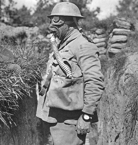 "An Australian chaplain wearing the ""Large Box Respirator"" also known as the ""Respiratory Tower"" during the First World War"