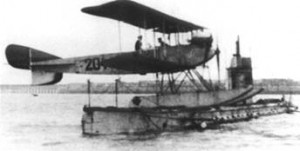 Friedrichshafen FF.29 seaplane on the deck of the German submarine U-12. Image in public domain.