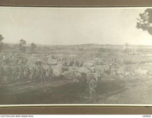 The 2nd Australian Infantry Brigade bivouac in wheatfields on the Gallipoli Peninsula, 6 May 1915. The Second Battle of Krithia is in progress on Achi Baba hill in the distance. CEW Bean. Image courtesy Australian War Memorial.