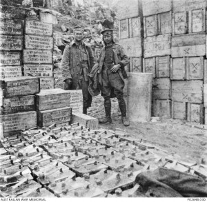 Two soldiers of the Supply Depot, 1st Australian Division, with boxes of corned beef and canned meat, Anzac Cove, 1915. Image courtesy Australian War Memorial.