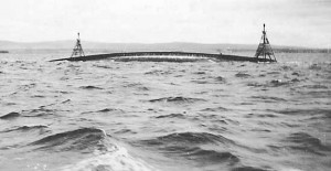 The upturned hull of HMS Natal in Cromarty Firth, 1915. Image in public domain.