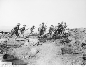 Australian soldiers stage a mock battle for photographic purposes prior to leaving Gallipoli, 18 December 1915. Image courtesy Australian War Memorial.