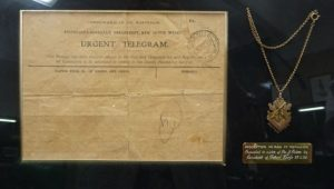 Telegram (illegible) advising James' sister Levine of his death. The residents of Forest Reefs presented the medallion on the right to Levine in 1920. Image courtesy WE Agland RSL MBE Memorial Museum Orange.