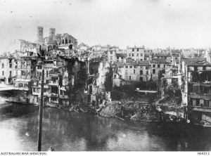 A section of the war damaged city of Verdun as seen from across the Meuse River 1916. Image courtesy Australian War Memorial.