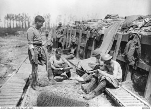 Australian soldiers relaxing near Armentieres 1916. The soldiers on the right are chatting; extracting lice - chats – from their clothing. Image courtesy Australian War Memorial.