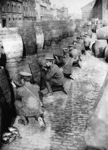 British Regulars sniping from behind a barricade of empty beer casks near the quays in Dublin during the 1916 Easter Rising.   (Photo by Hulton Archive/Getty Images)