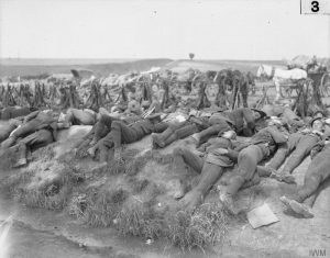 Exhausted British soldiers during the Battle of Bazentin Ridge, Western Front, Rrance, July 1916. Image courtesy Imperial War Museum ©IWM (Q 172).