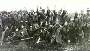 "Australian troops celebrate the capture of Pozieres, July 1916, posing as surrendering German soldiers and shouting ""mercy, kamerad"". Image courtesy Australian War Memorial."