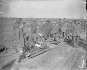 German prisoners and wounded troops of Grenadier Guards are offered cigarettes, Battle of Morval, 25 September 1916. Image courtesy Imperial War Museum © IWM (Q 4303).